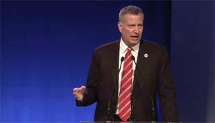 New York City Mayor Bill de Blasio delivers opening remarks.
