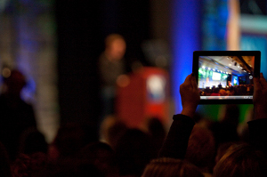 Photo of an attendee taking a smartphone photo