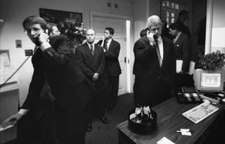 Pete Weissman (on phone at left) with President Clinton in the West Wing. [Photo by David Hume Kennerly]